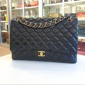 Chanel Classic maxi black lambskin gold hardware
